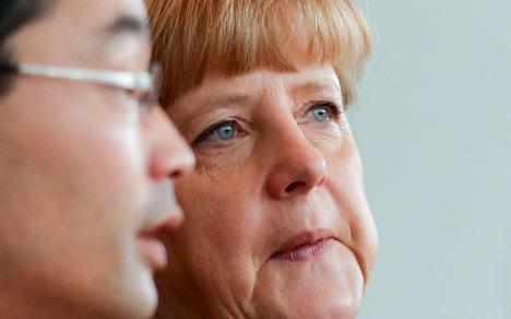 Merkel's coalition hits winning poll position