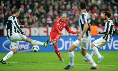 Bayern put a foot in Champion League semis