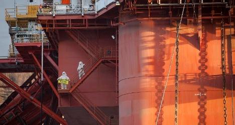 Greenpeace 'polar bears' protest Arctic oil drilling