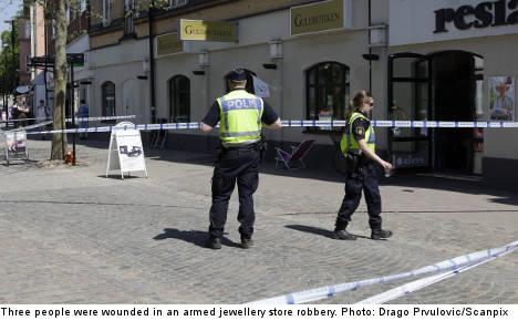 Three shot in jewellery heist on busy street