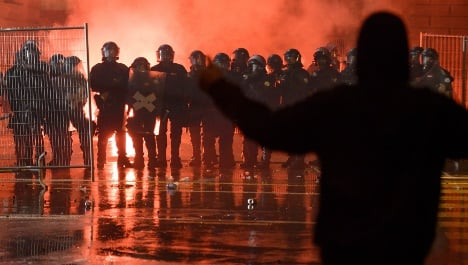 Swiss police clash with protesters at techno rally