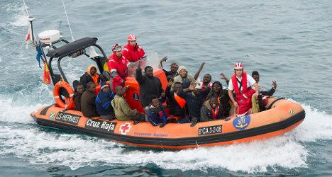 Spain authorities help rescue 66 migrants at sea