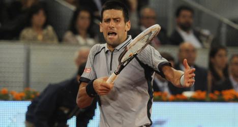 Ankle injury trips up Djokovic in Madrid