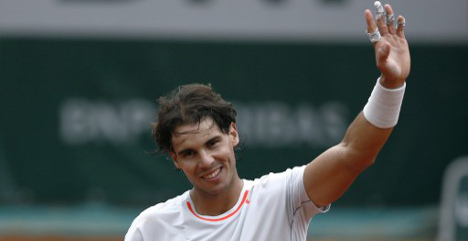 Nadal weathers poor start to progress in Paris