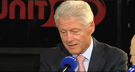 Clinton tells the French to be more positive