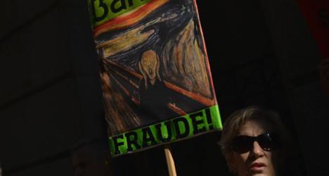 Spaniards rail at Bankia as savings evaporate
