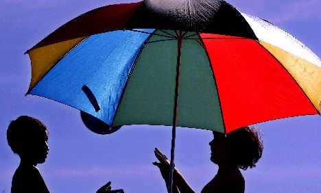 Firemen free toy-seeking toddler stuck in parasol