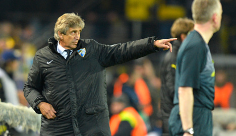 Malaga coach Pellegrini to join Man City: reports