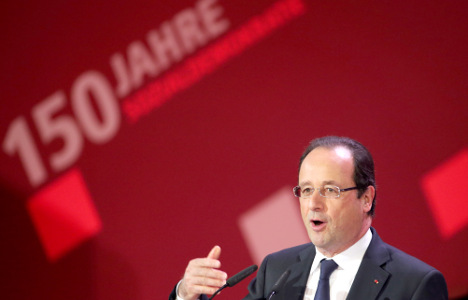 Hollande praises tough German reforms