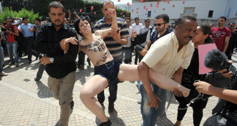 French feminists held after baring all in Tunisia