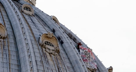 Anti-crisis protester climbs onto St Peter's