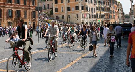 Crisis-hit Italians swap cars for bikes