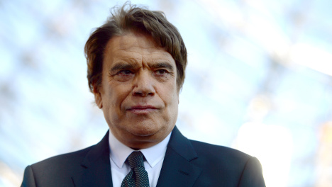 French tycoon Tapie charged with corruption