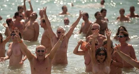 Nude Spaniards smash world 'skinny dip' record