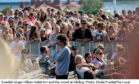 Why do sweaty Swedes sing along to pop stars?