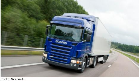 Scania plans production hike as profits fall