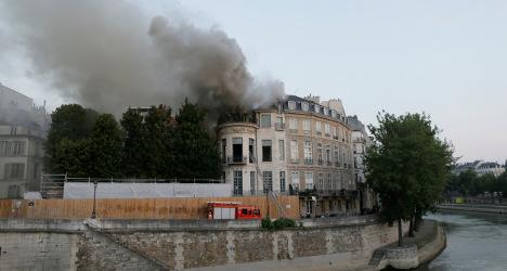 Qatar 'vows to' restore fire-hit Paris landmark