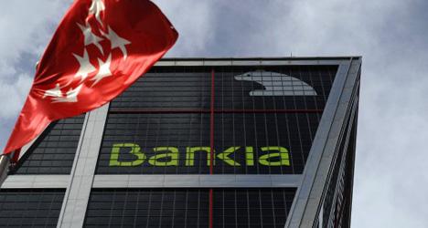 Downgrade deepens debt misery for Spanish banks
