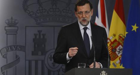 Defiant Spanish PM snubs resignation talk