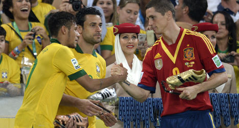 Wounded Spain defiant after Brazil defeat