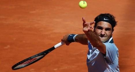 Federer to test new racquet at Swiss Open
