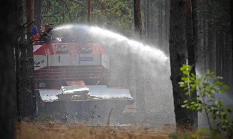 Firemen fight explosive forest inferno