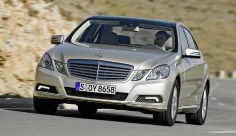 Daimler shares jump on upbeat forecast