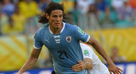 Cavani joins PSG in record French transfer