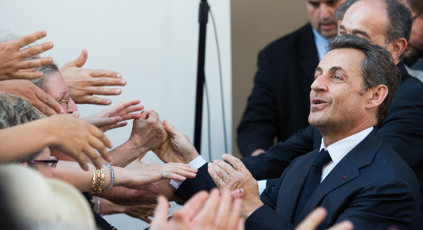 VIDEO: Sarkozy greeted like 'returning' hero