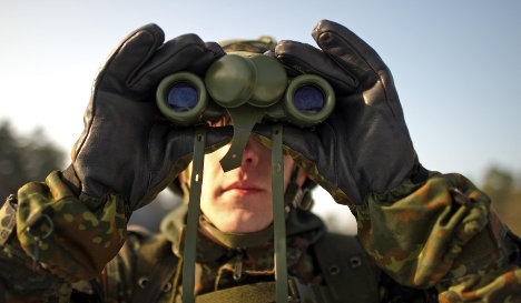 Merkel denies US spying 'old news' to army