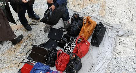 Italian police crack down on fake handbag sellers