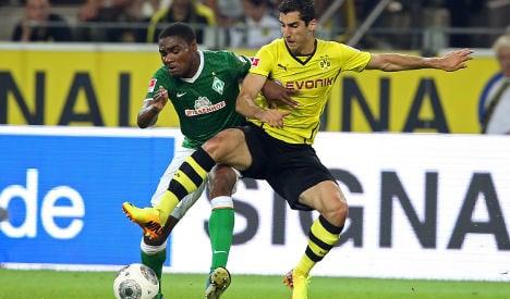 Dortmund down Bremen to stay top of Bundesliga