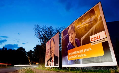 Steinbrück gains on Merkel but still trails