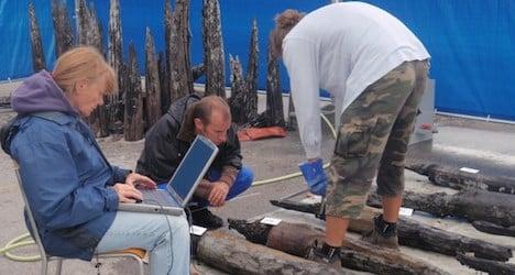 Prehistoric poles pitched in Lake Geneva protest