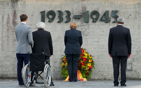 Controversy mars Merkel's Dachau visit