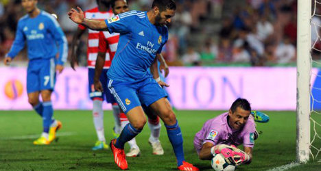 Benzema helps Real grind out Granada win