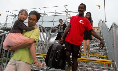 'It was racist to stop refugee luggage porters'