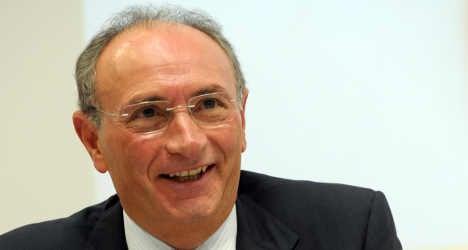 Italy's Unicredit reports profit plunge