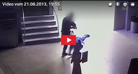 Video catches policeman kicking burglar's head