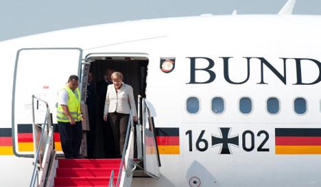 The man who gate-crashed Merkel's plane