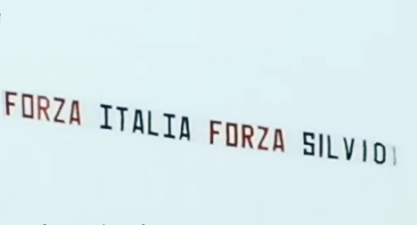 Berlusconi takes to skies to send holiday message