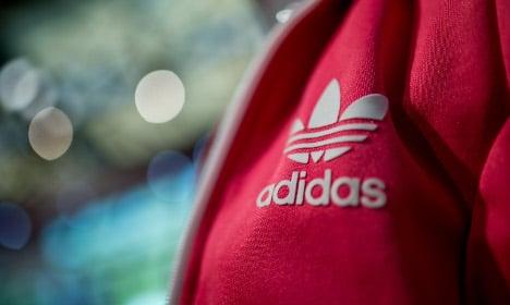 Adidas hits currency hurdles but profits up