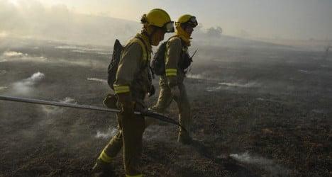 Firefighters battle wild blazes across Spain