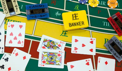 Gambling banker 'took €8.4m from customers'