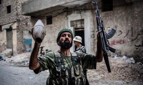 Merkel warms to Syria action, Germans say no