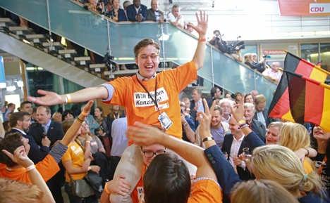 Merkel's CDU jubilant but coalition-cautious