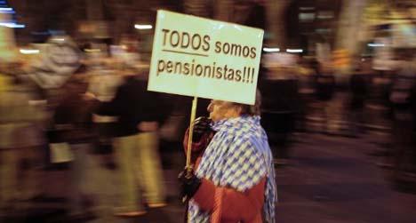 Spain sticks to unpopular cutbacks in 2014 budget