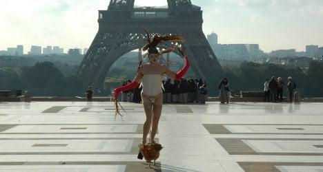 Coq-walking Paris artist: 'I'm totally normal'