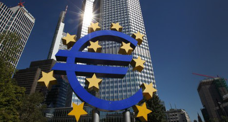 EU praises Spain's banks but wary over debt risk