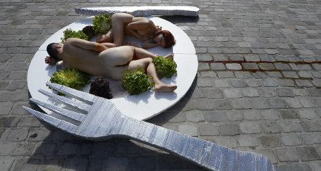 Naked vegetarians serve up 'plate of human flesh'